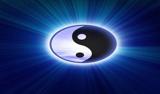 Yin yang symbol on a dark blue background